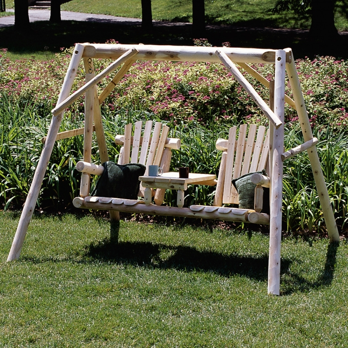 Ready to relax for two in our cedar log tete-a-tete yard swing.