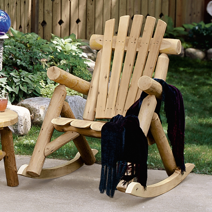 Take a seat outside in our Cedar Log Rocking Chair